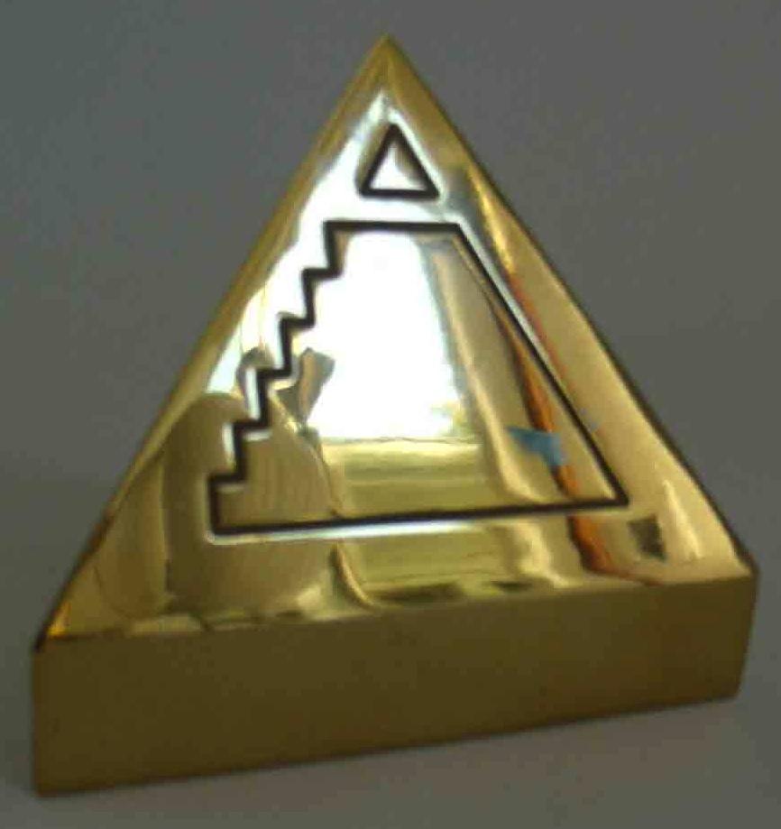 Machined brass paperweight